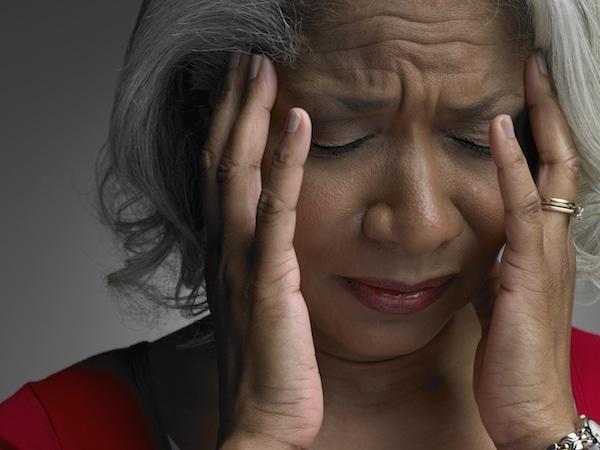 Woman suffering from a dizzy spell