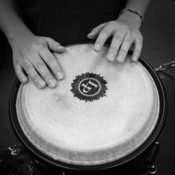 person playing the drums